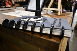 7 Cool Tabletop Gaming Products Showcased at Pax Unplugged - Unique RPG gaming swag and accessories - Mischief & Misadventure Campaign Planner (Gaming Journals) - dnd accessories - dungeons and dragons tabletop roleplaying