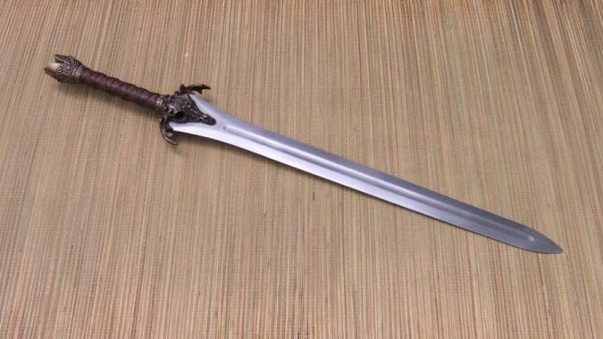 Use reference NMM images to paint non-metallic metal. Start with swords and open flat surfaces. This is a good reference image for painting NMM.