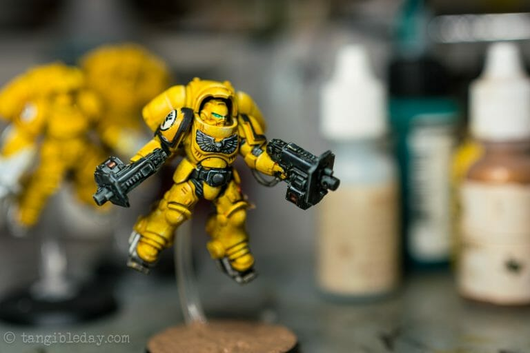 How-to Apply Warhammer Space Marine Decals (Tips) - How to use wet slide decals on miniatures and scale models - primaris inceptor imperial fist space marine table photo