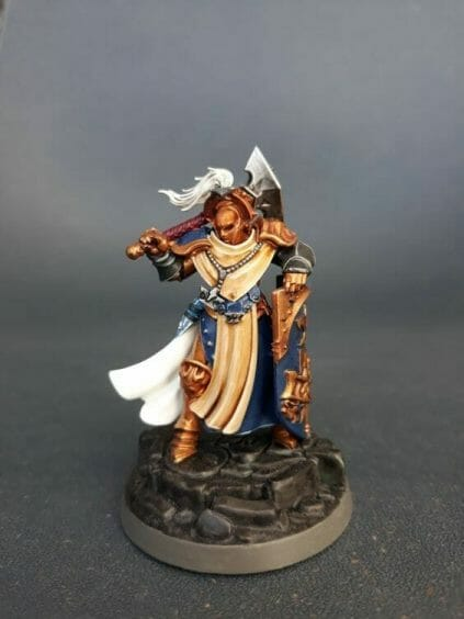 Stormcast Eternal Paint Schemes - 9 Color Motifs - how to paint stormcast eternals - color schemes for stormcast eternals, liberators, celestants, and other Age of Sigmar models from the Stormcast Eternal range - 9 color schemes for Stormcast Eternal models and miniatures from Citadel Games Workshop - a very orange gold armor with blue accent sequitur
