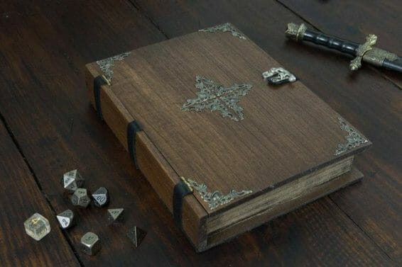 13 Cool Dice Trays for Tabletop Games – best dice trays for wargaming – Warhammer dice tray and storage – best dice tray for Warhammer 40k and miniature games – boardgame dice tray – best dice trays – dice trays for dungeons and dragons, D&D, and roleplaying games (RPG) – Spell Book Dice Tray Box with Metal Accent