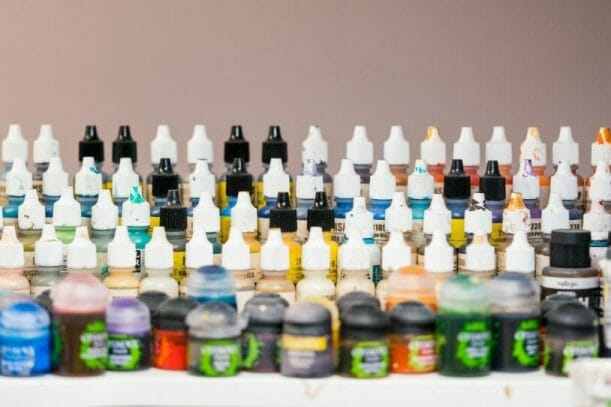 Best miniature painting cases, portable hobby paint station, and miniature paint workstations for modeling and hobbyists – Best portable hobby workstation for painting miniatures and models – tips and guide for paint organizers - model paint case and box - frontal view of paint rack dropper bottles and paints
