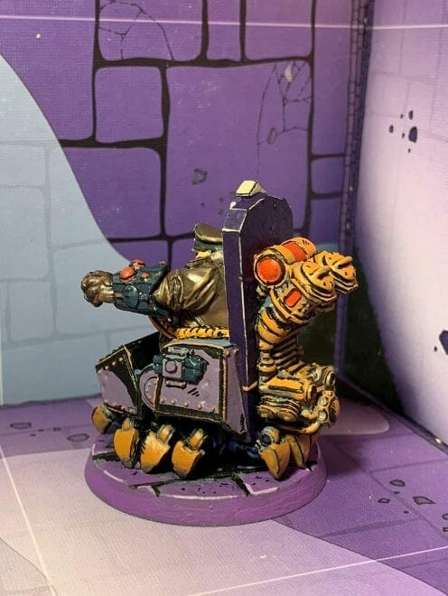 painting comic book miniatures - how to paint comic style miniatures - cel shaded miniature painting – how to paint cel shaded miniature – cell shaded miniature painting – miniature painting styles – how to paint cell shaded – borderlands miniature painting style – comic style painting - side shot model of inked miniature
