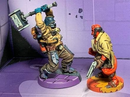 Painting comic book miniatures - how to paint comic style miniatures - cel shaded miniature painting – how to paint cel shaded miniature – cell shaded miniature painting – miniature painting styles – how to paint cell shaded – borderlands miniature painting style – comic style painting - cel shaded comic miniature painting - Übersoldaten from Reichbusters faces off against Hellboy
