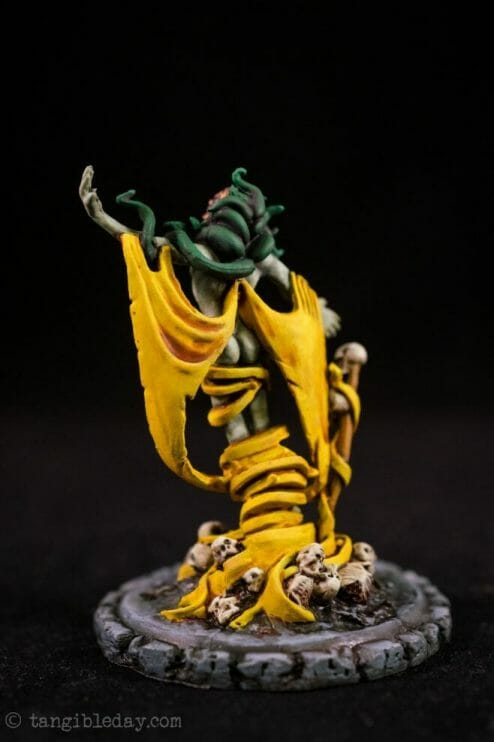How to paint yellow models – shading yellow miniatures – painting yellow miniatures – painting board game miniatures – Cthulhu wars painting – Petersen Games - how to shade yellow minis – how to paint yellow minis and models – quick yellow painting – best yellow paint - back view studio photo
