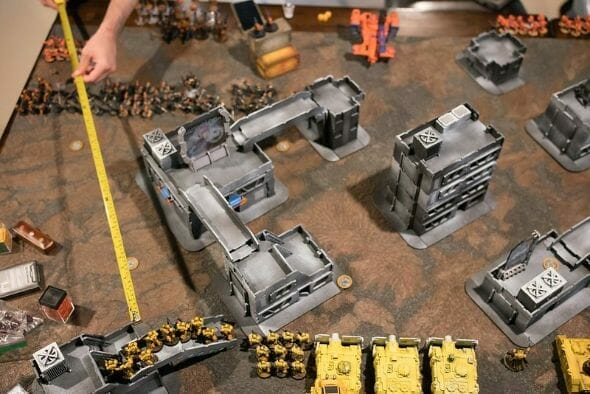 10 Great Wargaming Tables for RPGs and Tabletop Games - best game tables for RPGs - best wargaming table for warhammer - warhammer 40k game in progress