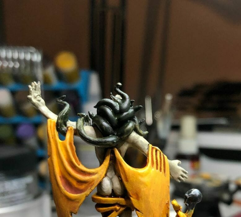 How to paint yellow models – shading yellow miniatures – painting yellow miniatures – painting board game miniatures – Cthulhu wars painting – Petersen Games - how to shade yellow minis – how to paint yellow minis and models – quick yellow painting – best yellow paint - close up  green snakes