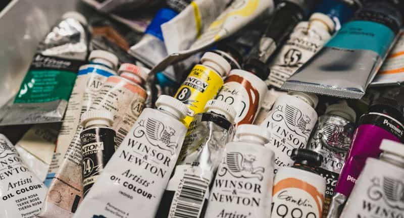 Oil paint tube stacked piles and unorganized - best paint tube storage racks and displays - how to store paint tubes