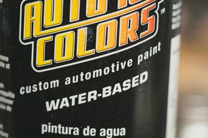 Top 3 Mistakes To Avoid When Priming Miniatures and Solutions -  tips for resolving and fixing primer issues on models - automotive primer bottle close up
