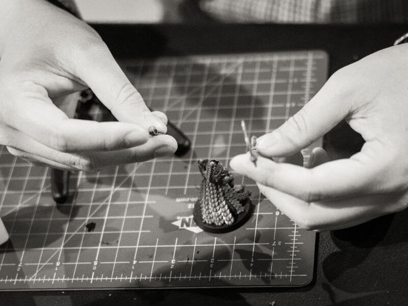 How Tabletop Miniature Gaming Can Help with PTSD - PTSD and tabletop games - wargames and PTSD - the benefits of tabletop games and boardgames for PTSD sufferers - assembling miniatures