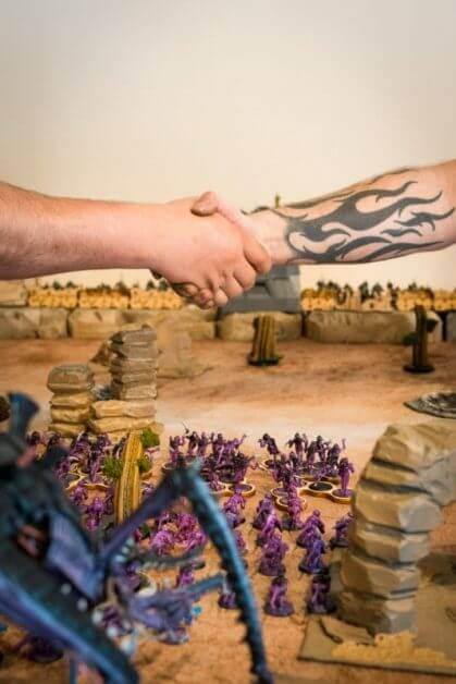 How Tabletop Miniature Gaming Can Help with PTSD - PTSD and tabletop games - wargames and PTSD - the benefits of tabletop games and boardgames for PTSD sufferers - end game handshake