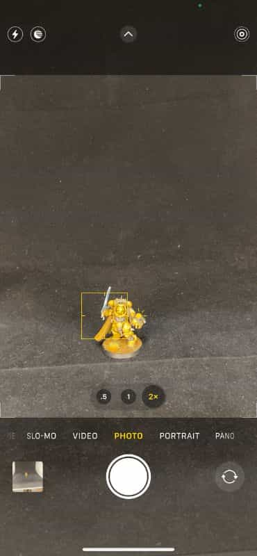 How to Photograph Miniatures with a Black Background (Guide) - how to capture miniature photos with pure black backdrops - infinite black backgrounds in miniature and model photography - guide for pure black background miniature photography - iphone miniature photography