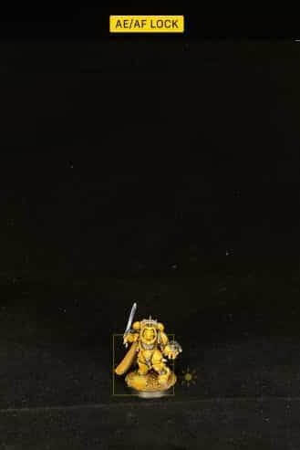 How to Photograph Miniatures with a Black Background (Guide) - how to capture miniature photos with pure black backdrops - infinite black backgrounds in miniature and model photography - guide for pure black background miniature photography - ae af feature for iphone smartphone photography