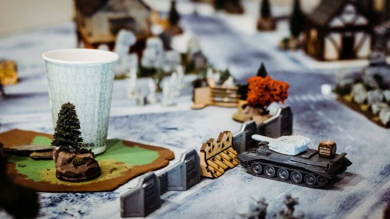 How Tabletop Miniature Gaming Can Help with PTSD - PTSD and tabletop games - wargames and PTSD - the benefits of tabletop games and boardgames for PTSD sufferers - a tank in a historical military tabletop miniature game, bolt action and konflikt