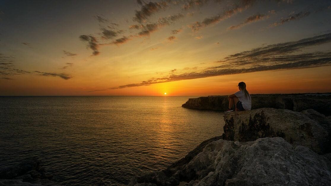 33 Reasons You Need To Take Photography, Seriously - personal reasons for photography - why photography - hobby photography -photo of person sitting on rock during sunset
