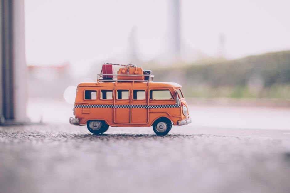 orange van die cast model on pavement - miniature hobby business ideas