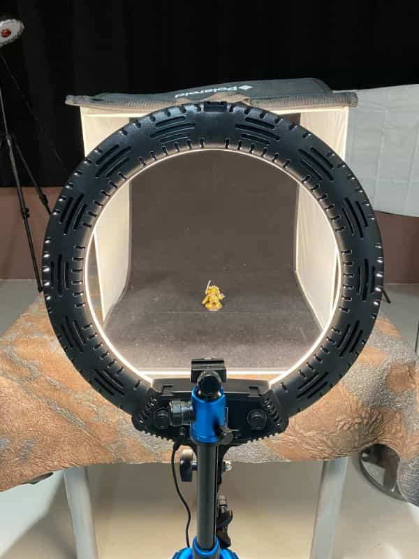 How to Photograph Miniatures with a Black Background (Guide) - how to capture miniature photos with pure black backdrops - infinite black backgrounds in miniature and model photography - guide for pure black background miniature photography - ring light setup for black backdrop photography
