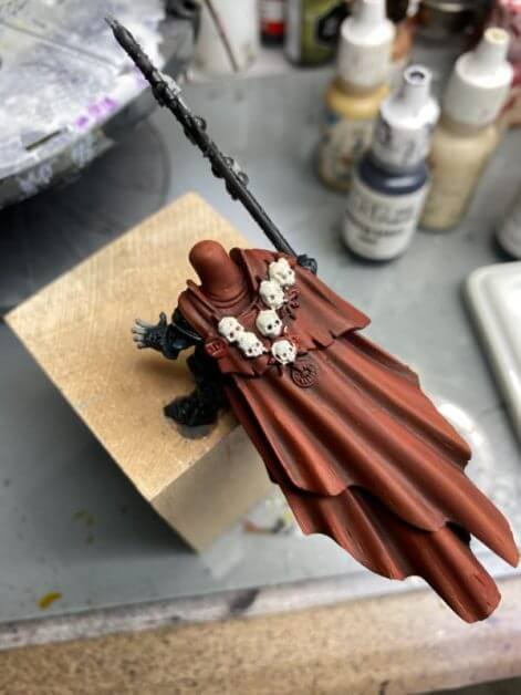 How to Paint Skulls and Bone on Miniatures (3 Easy Steps) - skulls painted with base color ivory