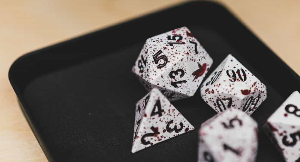 Best Metal Dice Sets? Forged Gaming Dice Sets for DnD and RPGs (Review) - metal dice set review - close up blood effects