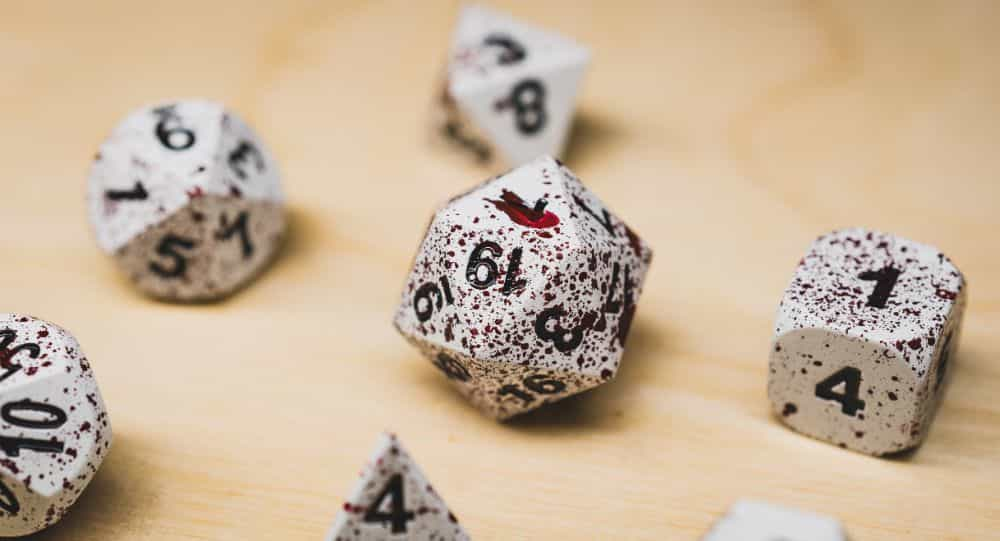 Best Metal Dice Sets? Forged Gaming Dice Sets for DnD and RPGs (Review) - metal dice set review - blood close up