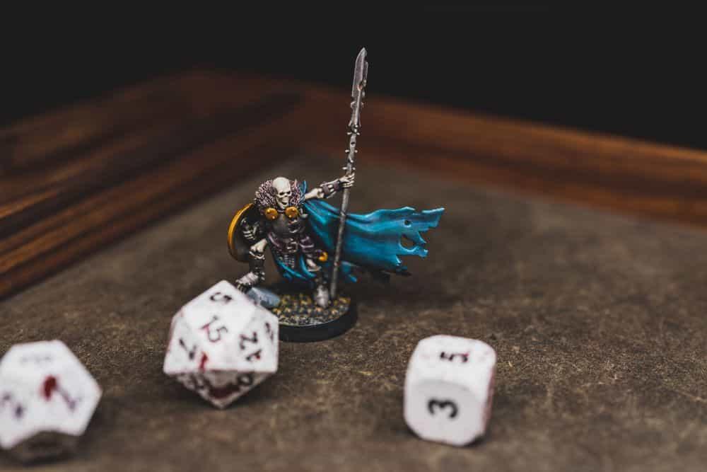 Best Metal Dice Sets? Forged Gaming Dice Sets for DnD and RPGs (Review) - metal dice set review - miniature skeleton