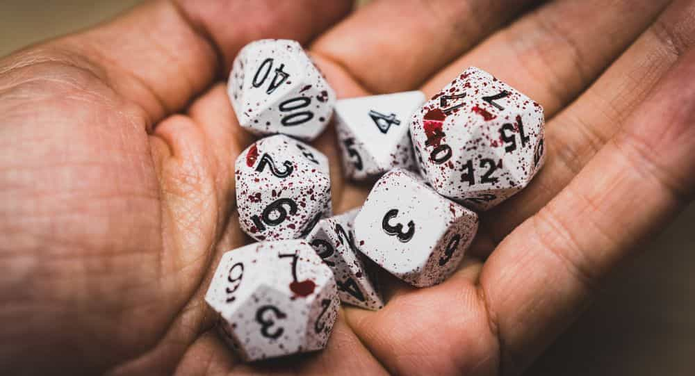 Best Metal Dice Sets? Forged Gaming Dice Sets for DnD and RPGs (Review) - metal dice set review - dice in hand