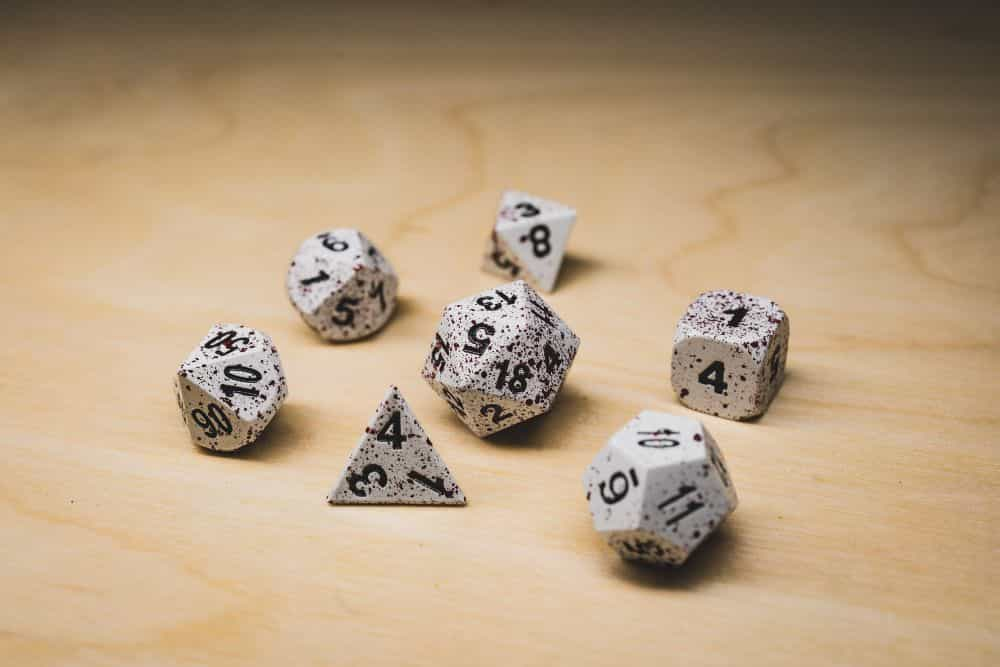 Best Metal Dice Sets? Forged Gaming Dice Sets for DnD and RPGs (Review) - metal dice set review - winter dice with blood