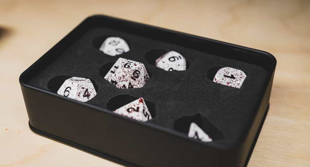 Best Metal Dice Sets? Forged Gaming Dice Sets for DnD and RPGs (Review) - metal dice set review - dice in foam